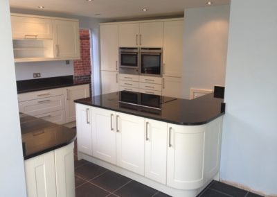 Matt Ivory Kitchen & Black Granite Worktops