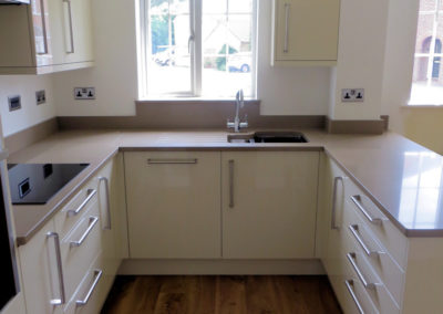 High Gloss Stone units, Silestone Toffee worktops with undermount sink & CDA boiling water tap