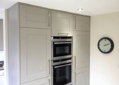 Stone painted oak bank housing Neff ovens & warming drawer