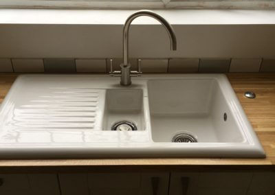 Fireclay sink & waste disposal activator