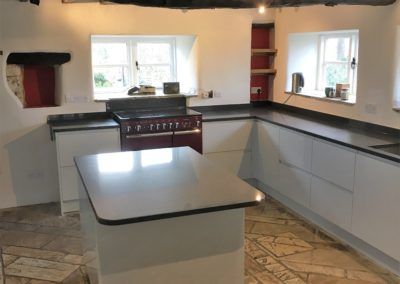 Light Grey High Gloss J Pull units finished with Silestone Blue Arden Polished Worktops
