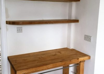 Purpose build oak shelving and adapted butcher's block