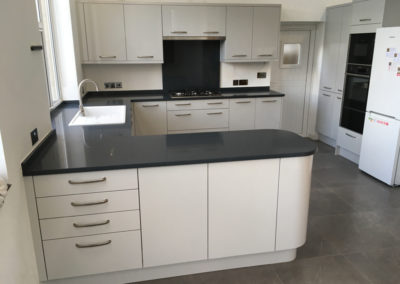 Light Grey Gloss Kitchen with Silestone Charcoal Soapstone worktops