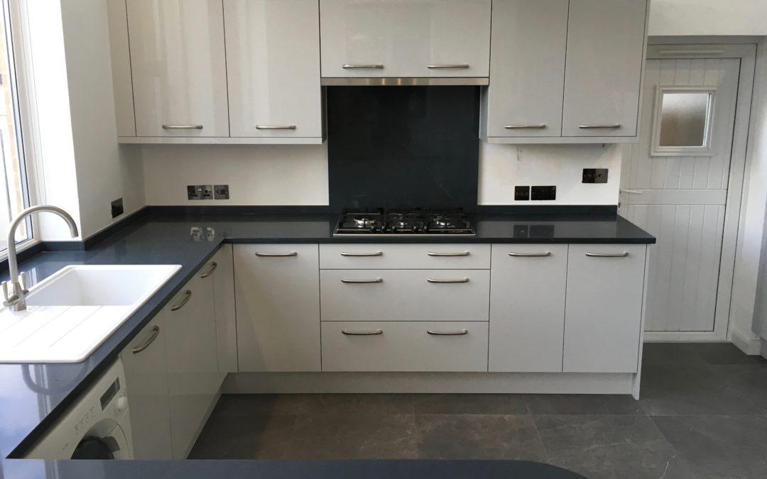 Light Grey Gloss Kitchen & Silestone Charcoal Soapstone Worktops