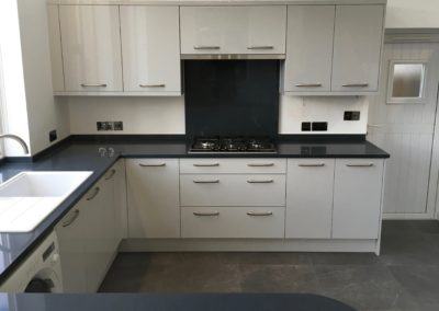 Light Grey Gloss Kitchen & Silestone Charcoal Soapstone Worktops