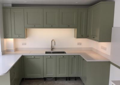 Sage Grey Ash kitchen with Silestone White North worktops