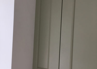 Spacer cupboard to even the wall mounted units