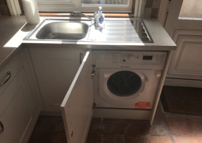 Sink and integrated washing machine