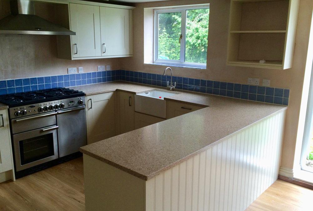 Broadoak Painted Alabaster Kitchen & Silestone Eco Red Pine Worktops
