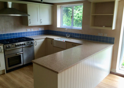 Broadoak Painted Alabaster Kitchen & Silestone Eco Red Pine Worktops