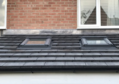 Velux windows fitted and roof finished